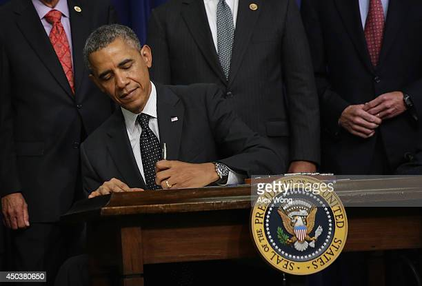 S President Barack Obama signs HR 1726 to award a Congressional Gold Medal to the 65th Infantry Regiment known as the Borinqueneers into law June 10...