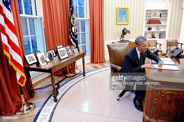 US President Barack Obama signs HR 2747 Streamlining Claims Processing for Federal Contractor Employees Act and S 893 Veterans Compensation...