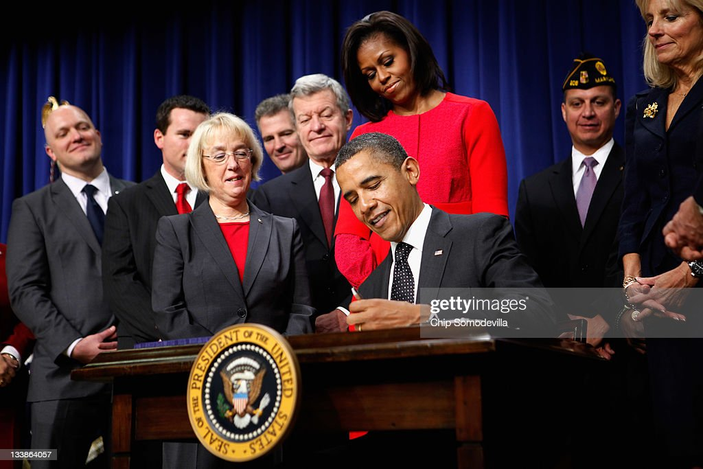 U.S. President Barack Obama (C) signs legislation into law that will provide business tax credits to help put veterans back to work during a ceremony with (3rd L to R) Sen. Patty Murray (D-WA), Sen. Scott Brown (R-MA), Sen. Max Baucus (D-MT), first lady Michelle Obama and Jill Biden (R) at the Eisenhower Executive Office Building November 21, 2011 in Washington, DC. The first element of the president's jobs package, the bill passed the House 422-0, six days after the Senate passed it 95-0. The jobless rate for veterans of the Iraq and Afghanistan wars is 12.1 percent, White House officials said, compared with 9 percent for the population at large. The law would give businesses a tax credit of as much as $9,000 if they hired a disabled veteran who had been out of work for more than six months, a $5,600 credit for hiring any veteran unemployed for at least six months and $2,400 for hiring a veteran out of work for at least a month.