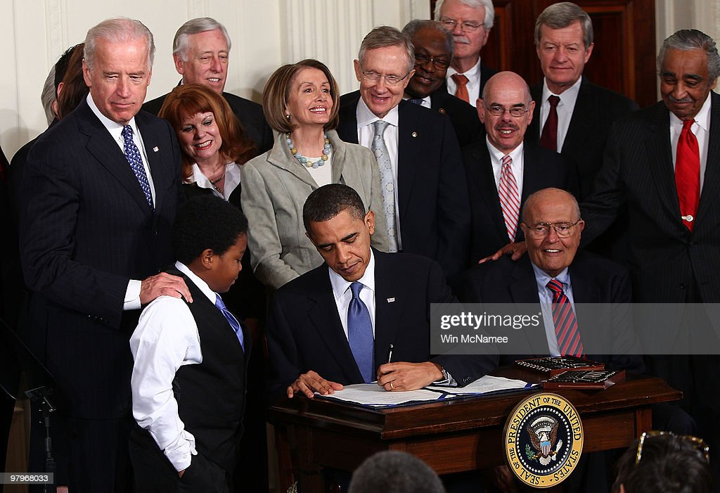 U.S. President <a gi-track='captionPersonalityLinkClicked' href=/galleries/search?phrase=Barack+Obama&family=editorial&specificpeople=203260 ng-click='$event.stopPropagation()'>Barack Obama</a> signs the Affordable Health Care for America Act during a ceremony with fellow Democrats in the East Room of the White House March 23, 2010 in Washington, DC. The historic bill was passed by the House of Representatives Sunday after a 14-month-long political battle that left the legislation without a single Republican vote.