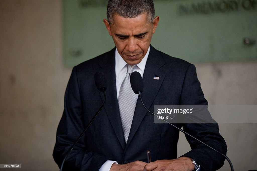 U.S. President Barack Obama signs the guest book during his visit to the Yad Vashem Holocaust Memorial museum on March 22, 2013 in Jerusalem, Israel. This is Obama's first visit as president to the region and his itinerary includes meetings with the Palestinian and Israeli leaders as well as a visit to the Church of the Nativity in Bethlehem.