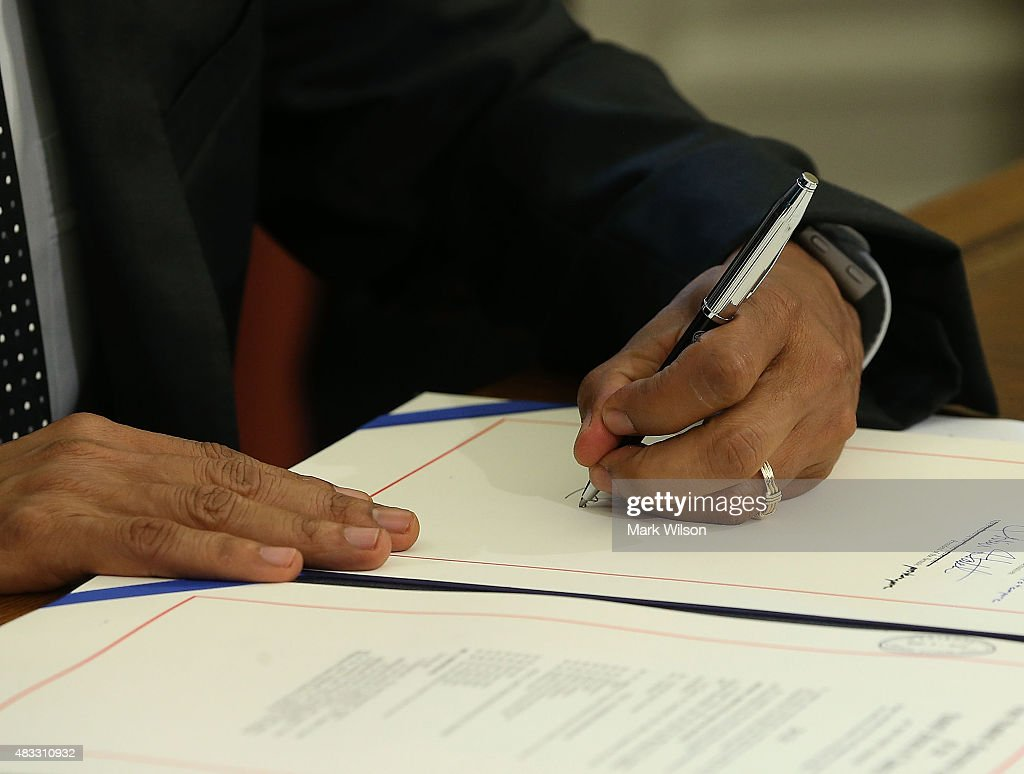 US President Barack Obama signs the H.R. 1138 Sawtooth National Recreation Area and Jerry Peak Wilderness Additions Act. in the Oval Office at the White House, August 7, 2015 in Washington, DC. Later today President Obama and his family will be departing for a two week vacation on Martha's Vineyard in Massachusetts.