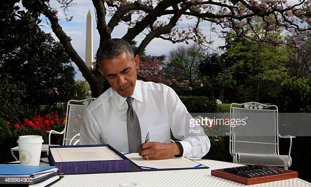 S President Barack Obama signs the Medicare Access CHIP Reauthorization Act 2015 on April 16 2015 in Washington DC HR 2 commonly known as 'Doc Fix'...