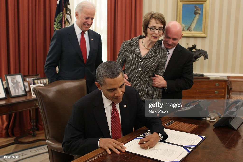 S President Barack Obama signs the Ultralight Aircraft Smuggling Prevention Act of 2012 as US Vice President Joe Biden former US Rep Gabrielle...