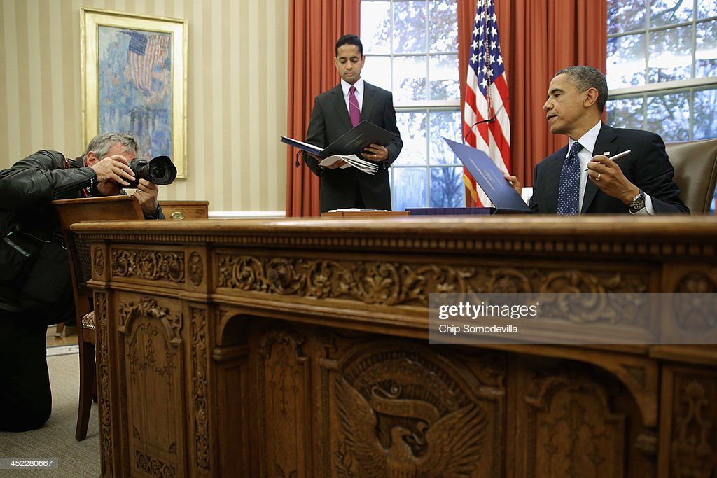 oval office desk. us president barack obama r signs three bills into law on the resolute desk oval office