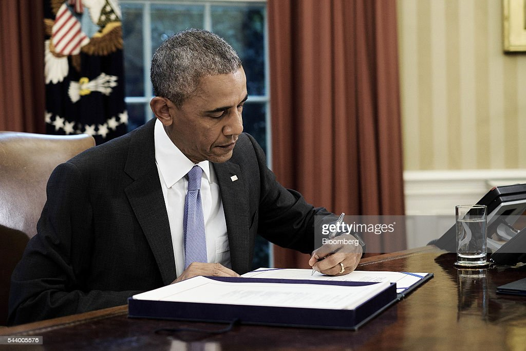 U.S. President <a gi-track='captionPersonalityLinkClicked' href=/galleries/search?phrase=Barack+Obama&family=editorial&specificpeople=203260 ng-click='$event.stopPropagation()'>Barack Obama</a> signs two bills, S. 2328: Puerto Rico Oversight, Management, and Economic Stability Act and S. 337: FOIA Improvement Act of 2016, in the Oval Office of the White House in Washington, D.C., U.S., on Thursday, June 30, 2016. Obama signed the bipartisan legislation that creates a financial control board to help restructure Puerto Ricos $70 billion in debt and oversee the islands finances, marking the largest federal intervention ever into the U.S. municipal bond market. Photographer: T.J. Kirkpatrick/Bloomberg via Getty Images