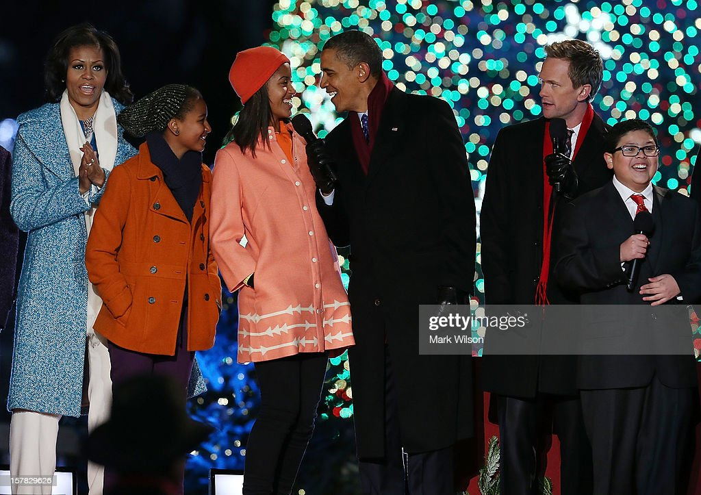 U.S. President <a gi-track='captionPersonalityLinkClicked' href=/galleries/search?phrase=Barack+Obama&family=editorial&specificpeople=203260 ng-click='$event.stopPropagation()'>Barack Obama</a>, sings a Christmas song with his daughters Malia (3rd-L) and Sasha (2nd-L), first lady <a gi-track='captionPersonalityLinkClicked' href=/galleries/search?phrase=Michelle+Obama&family=editorial&specificpeople=2528864 ng-click='$event.stopPropagation()'>Michelle Obama</a> (L), Actor <a gi-track='captionPersonalityLinkClicked' href=/galleries/search?phrase=Neil+Patrick+Harris&family=editorial&specificpeople=210509 ng-click='$event.stopPropagation()'>Neil Patrick Harris</a> (2nd-R), and Rico Rodriguez (R),during the annual lighting of the National Christmas tree on December 6, 2012 in Washington, DC. This year is the 90th annual National Christmas Tree Lighting Ceremony.
