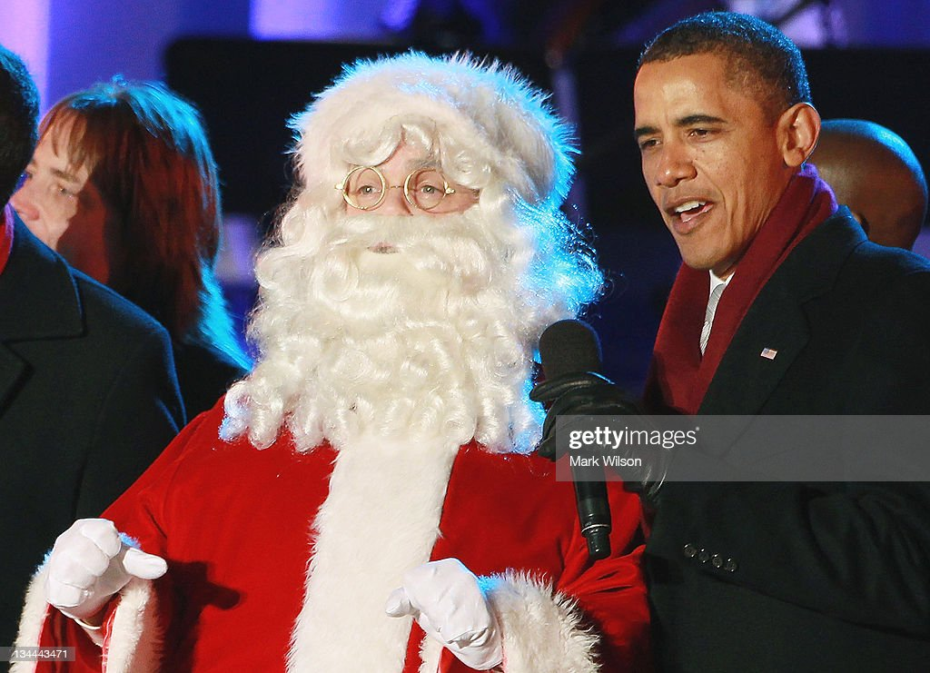 U.S. President <a gi-track='captionPersonalityLinkClicked' href=/galleries/search?phrase=Barack+Obama&family=editorial&specificpeople=203260 ng-click='$event.stopPropagation()'>Barack Obama</a> (R) sings a song with Santa Clause during the National Christmas Tree lighting ceremony on December 1, 2011 at the Ellipse, south of the White House, in Washington, DC. The first family participated in the 89th annual National Christmas Tree Lighting Ceremony.