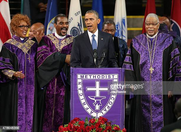 President Barack Obama sings 'Amazing Grace' as he delivers the eulogy for South Carolina state senator and Rev Clementa Pinckney during Pinckney's...
