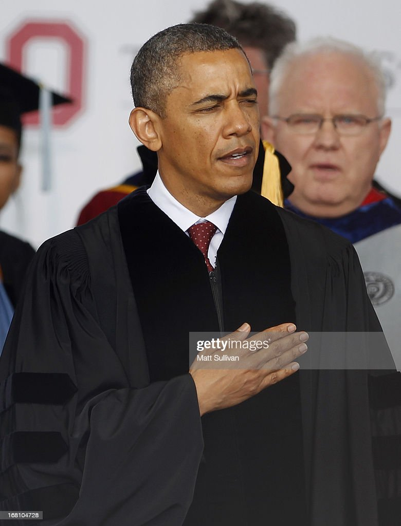 U.S. President <a gi-track='captionPersonalityLinkClicked' href=/galleries/search?phrase=Barack+Obama&family=editorial&specificpeople=203260 ng-click='$event.stopPropagation()'>Barack Obama</a> sings the national anthem before his commencement address to the graduating class of The Ohio State University at Ohio Stadium on May 5, 2013 in Columbus, Ohio. Obama addressed the graduates a year from the day he kicked off his re-election campaign at the campus.The president was also given an honorary degree Doctor of Laws.