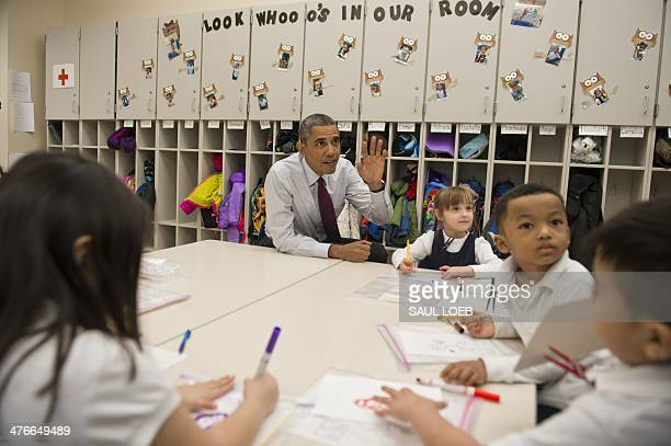 US President Barack Obama sits alongside children during a tour of a PreK classroom at Powell Elementary School prior to speaking on the Fiscal Year...
