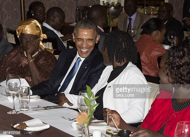US President Barack Obama sits alongside his stepgrandmother Mama Sarah and halfsister Auma Obama during a gathering of family at his hotel in...