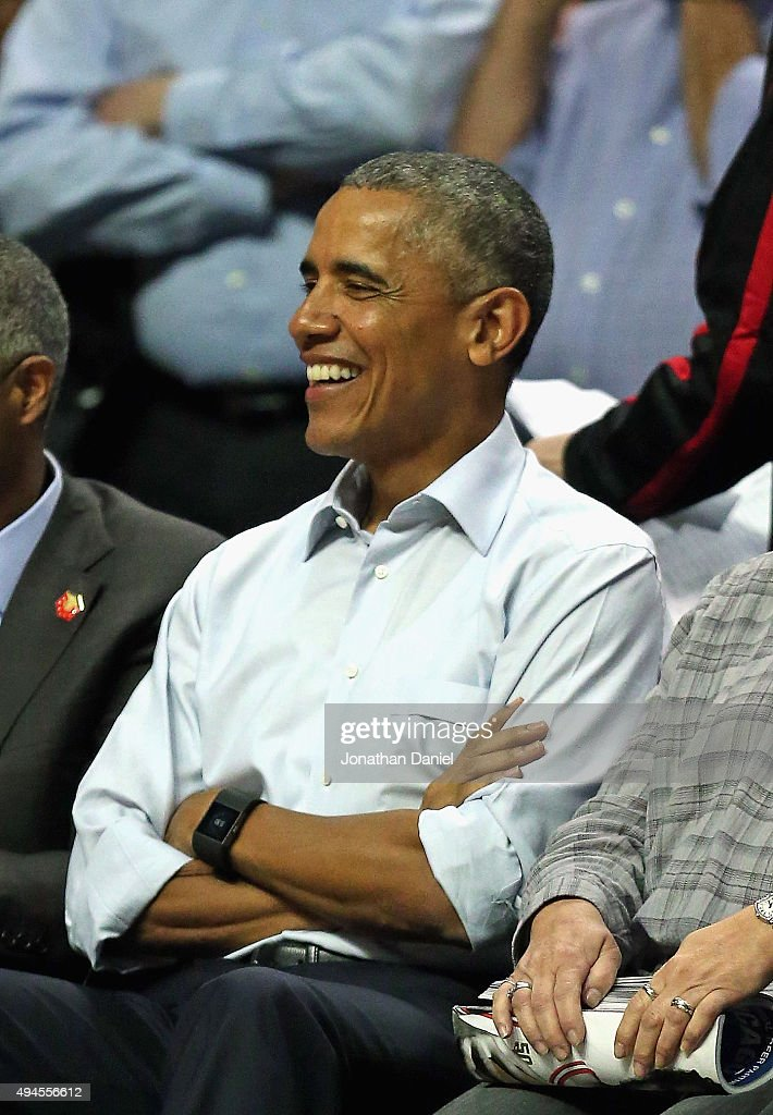 President Barack Obama sits courtside as the Chicago Bulls take on the Cleveland Cavaliers during the season opening game at the United Center on October 27, 2015 in Chicago, Illinois. Note to User: User expressly acknowledges and agrees that, by downloading and or using the photograph, User is consenting to the terms and conditions of the Getty Images License Agreement.