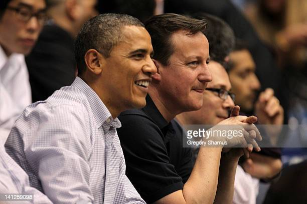 S President Barack Obama sits with British Prime Minister David Cameron at UD Arena to watch the Western Kentucky Hilltoppers take on the Mississippi...