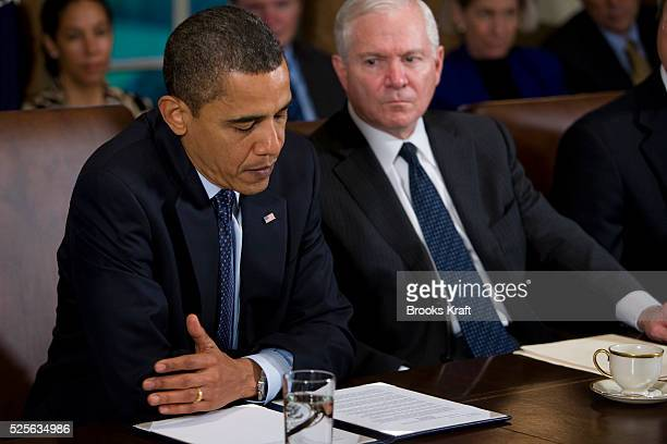 'President Barack Obama sitting next to Defense Secretary Robert Gates right pauses as he speaks during a meeting with members of his Cabinet in the...