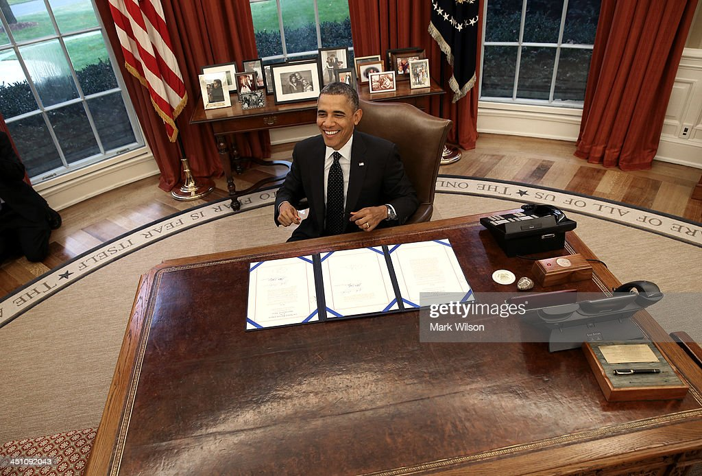 President <a gi-track='captionPersonalityLinkClicked' href=/galleries/search?phrase=Barack+Obama&family=editorial&specificpeople=203260 ng-click='$event.stopPropagation()'>Barack Obama</a> smiles after bill signing in the Oval Office at the White House, on November 21, 2013 in Washington, DC. President Obama signed three bills titled H.R. 2747, Streamlining Claims Processing for Federal Contractor Employees Act, S. 330, HIV Organ Policy Equity Act, and S. 893, Veterans Compensation Cost of Living Adjustment Act of 2013.