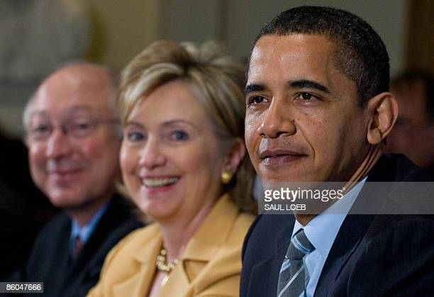US President Barack Obama smiles alongside Secretary of State Hillary Clinton and Secretary of the Interior Ken Salazar during his first cabinet...