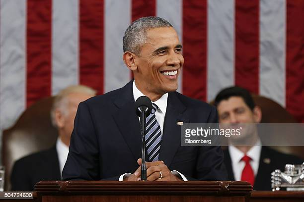 US President Barack Obama smiles as he delivers the State of the Union address to a joint session of Congress at the Capitol in Washington DC US on...