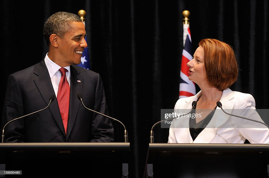 US President <a gi-track='captionPersonalityLinkClicked' href=/galleries/search?phrase=Barack+Obama&family=editorial&specificpeople=203260 ng-click='$event.stopPropagation()'>Barack Obama</a> smiles as he listens to Australian Prime Minister <a gi-track='captionPersonalityLinkClicked' href=/galleries/search?phrase=Julia+Gillard&family=editorial&specificpeople=787281 ng-click='$event.stopPropagation()'>Julia Gillard</a> during a Joint Media Conference on the first day of his 2-day visit to Australia, on November 16, 2011 in Canberra, Australia. The President will today receive a Cermeonial Welcome, attend a bi-lateral meeting and hold a joint media conference with <a gi-track='captionPersonalityLinkClicked' href=/galleries/search?phrase=Julia+Gillard&family=editorial&specificpeople=787281 ng-click='$event.stopPropagation()'>Julia Gillard</a>, and attend a Parliamentary Dinner this evening, before addressing Parliament and heading to Darwin tomorrow.
