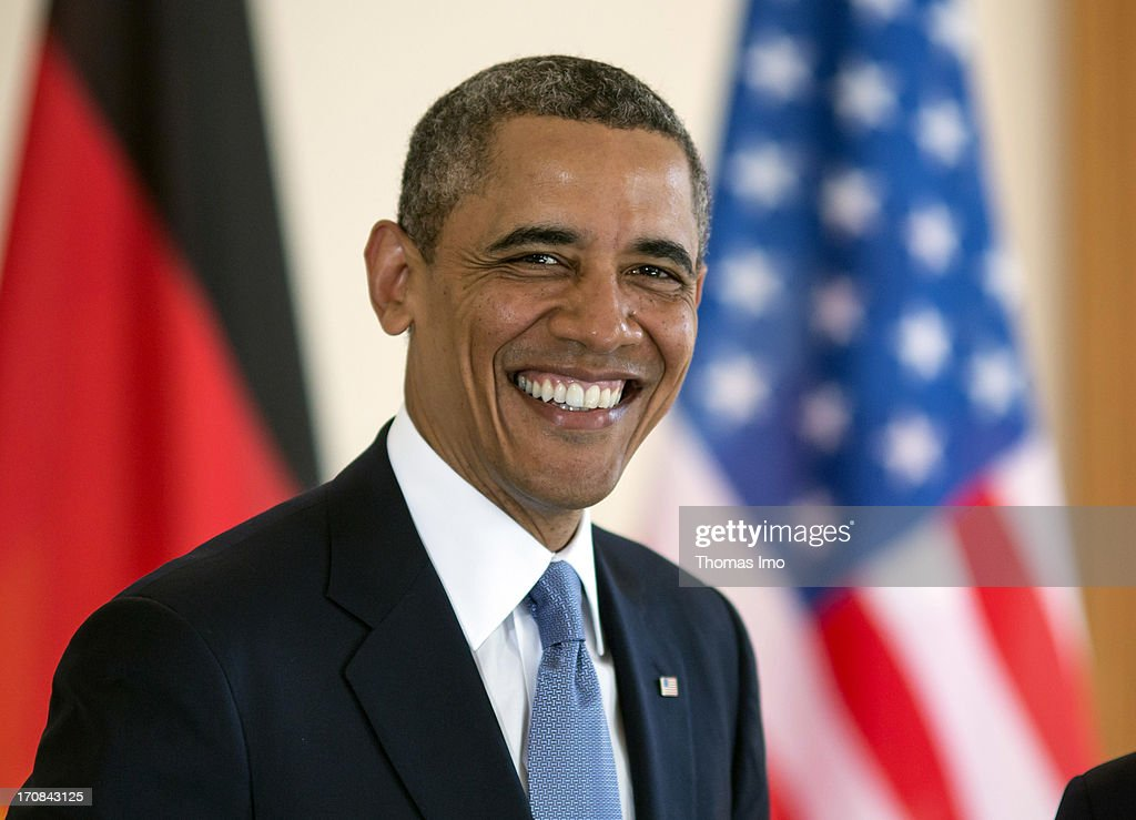 U.S. President <a gi-track='captionPersonalityLinkClicked' href=/galleries/search?phrase=Barack+Obama&family=editorial&specificpeople=203260 ng-click='$event.stopPropagation()'>Barack Obama</a> smiles as he signs the official guest book at Bellevue Palace on June 19, 2013 in Berlin, Germany. U.S. President <a gi-track='captionPersonalityLinkClicked' href=/galleries/search?phrase=Barack+Obama&family=editorial&specificpeople=203260 ng-click='$event.stopPropagation()'>Barack Obama</a> is visiting Berlin for the first time during his presidency and his speech at the Brandenburg Gate is to be the highlight. Obama will be speaking close to the 50th anniversary of the historic speech by then U.S. President John F. Kennedy in Berlin in 1963.