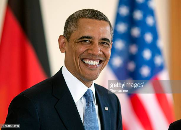 S President Barack Obama smiles as he signs the official guest book at Bellevue Palace on June 19 2013 in Berlin Germany US President Barack Obama is...