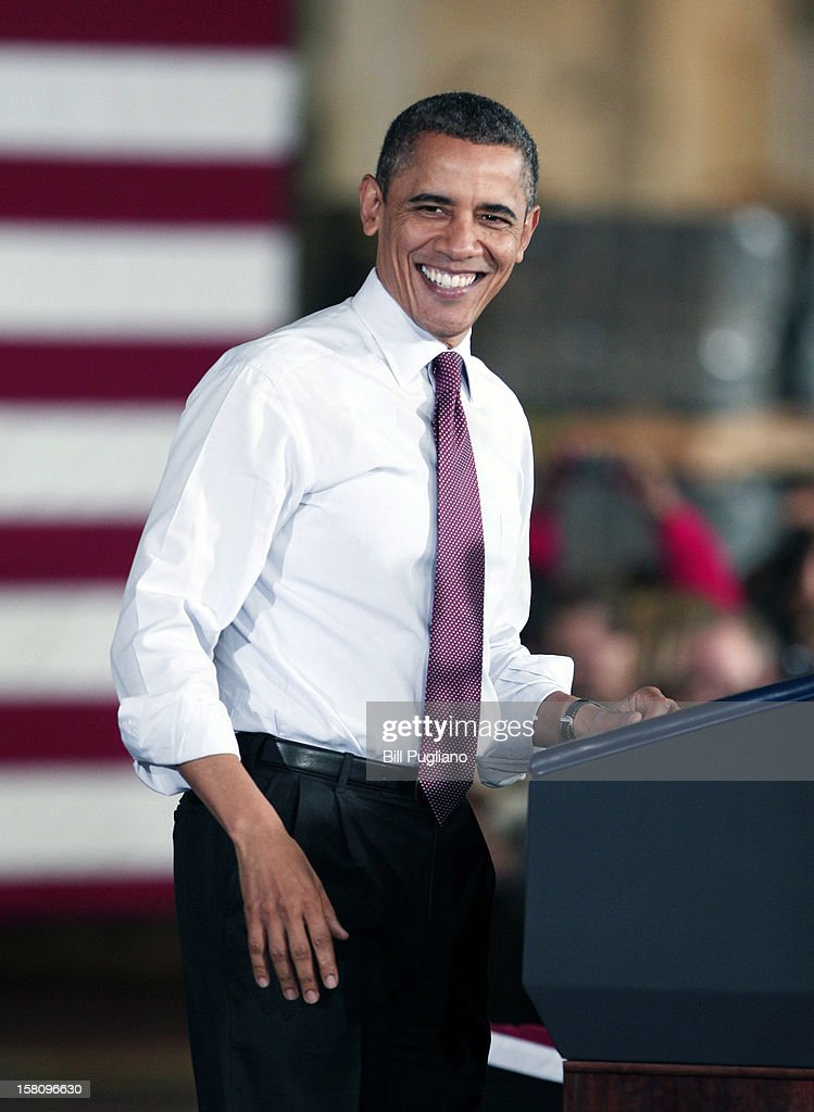 U.S. President <a gi-track='captionPersonalityLinkClicked' href=/galleries/search?phrase=Barack+Obama&family=editorial&specificpeople=203260 ng-click='$event.stopPropagation()'>Barack Obama</a> smiles as he speaks about the economy at the Daimler Detroit Diesel engine plant December 10, 2012 in Redford, Michigan. The President and Congress have not yet come to an agreement regarding how to extend the Bush-era tax cuts, which expire at the end of this year (the so-called 'fiscal cliff'). Republicans in Congress want the tax cuts to continue to apply to all tax payers, whereas the President wants them to apply only to tax payers who earn less than $250,000 a year.