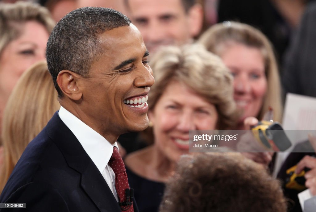 S President Barack Obama smiles broadly after a town hall style presidential debate at Hofstra University October 16 2012 in Hempstead New York...