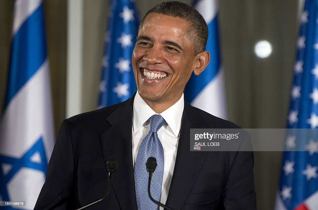 US President Barack Obama smiles during a joint press conference with Israeli Prime Minister Benjamin Netanyahu (unseen) at the Prime Minister's Residence in Jerusalem, on March 20, 2013, on the first day of Obama's three day trip to Israel and the Palestinian Territories. AFP PHOTO / Saul LOEB