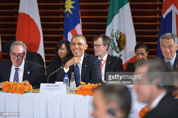US President Barack Obama smiles during a meeting with leaders from the TransPacific Partnership at the US embassy in Beijing on November 10 2014 Top...