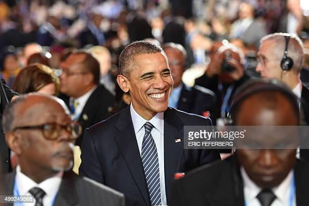 US President Barack Obama smiles during the inaugural session of the COP 21 United Nations conference on climate change on November 30 2015 at Le...