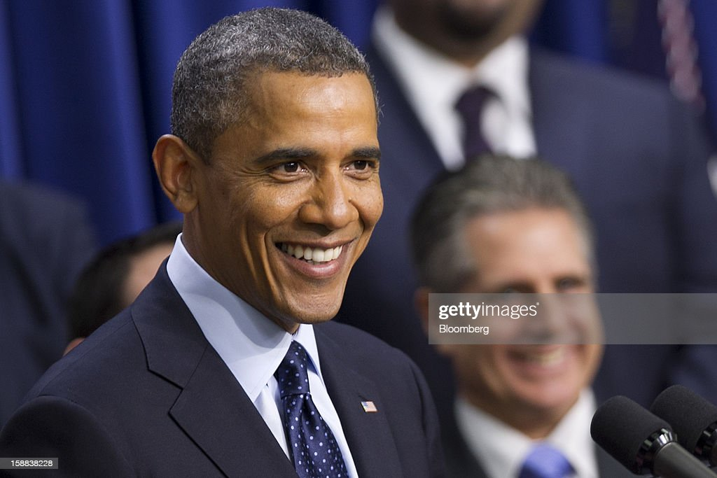 U.S. President Barack Obama smiles while speaking in the South Court Auditorium of the Eisenhower Executive Building next to the White House in Washington, D.C., U.S., on Monday, Dec. 31, 2012. Obama, backed by a group of of people described by the White House as 'middle class Americans,' said an agreement on the so-called fiscal cliff is 'within sight,' but 'it's not done.' Photographer: Andrew Harrer/Bloomberg via Getty Images
