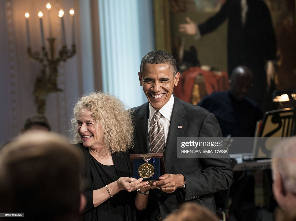US President Barack Obama smiles with singer and song writer Carole King after presenting her the Gershwin Prize for Popular Song during the Gershwin Prize Concert in the East Room of the White House May 22, 2013 in Washington, DC. The Obamas hosted the performance to honor singer and song writer Carole King's Gershwin Prize. AFP PHOTO/Brendan SMIALOWSKI
