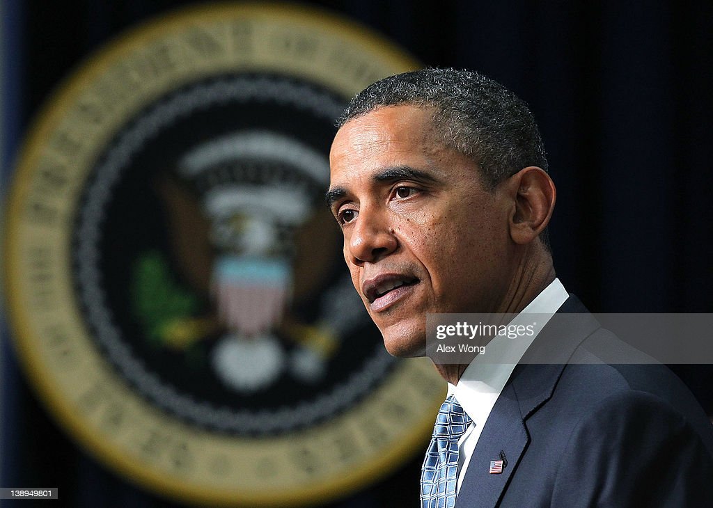 S President Barack Obama speaks about a payroll tax cut and unemployment insurance February 14 2012 at the South Court Auditorium of the Eisenhower...