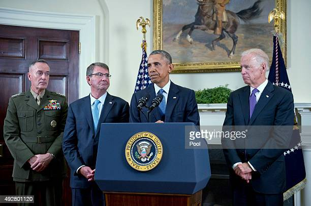 S President Barack Obama speaks about Afghanistan troop withdrawals in the Roosevelt Room of the White House as US Marine Corps General Joseph F...