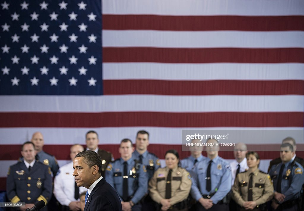 US President Barack Obama speaks about gun violence at the Minneapolis Police Department's special operations center on February 4, 2013 in Minneapolis, Minnesota. Obama spoke after meeting with local leaders and law enforcement to discuss gun violence and local efforts to control it. AFP PHOTO/Brendan SMIALOWSKI