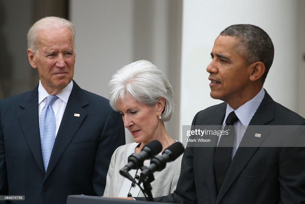 U.S. President Barack Obama (R) speaks about outgoing Health and Human Services Secretary Kathleen Sebelius (C) while U.S. Vice President Joe Biden listens during an event in the Rose Garden at the White House, on April 11, 2014 in Washington, DC. President Obama announced his nomination of Director of the White House Office of Management and Budget Sylvia Mathews Burwell to replace Secretary Sebelius.