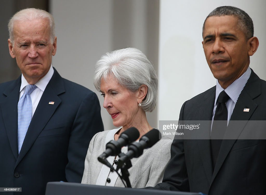 U.S. President Barack Obama (R) speaks about outgoing Health and Human Services Secretary Kathleen Sebelius (C) while U.S. Vice President Joe Biden listens during an event in the Rose Garden at the White House, on April 11, 2014 in Washington, DC. President Obama announced his nomination of Director of the White House Office of Management and Budget Sylvia Mathews Burwell to succeed Sebelius.