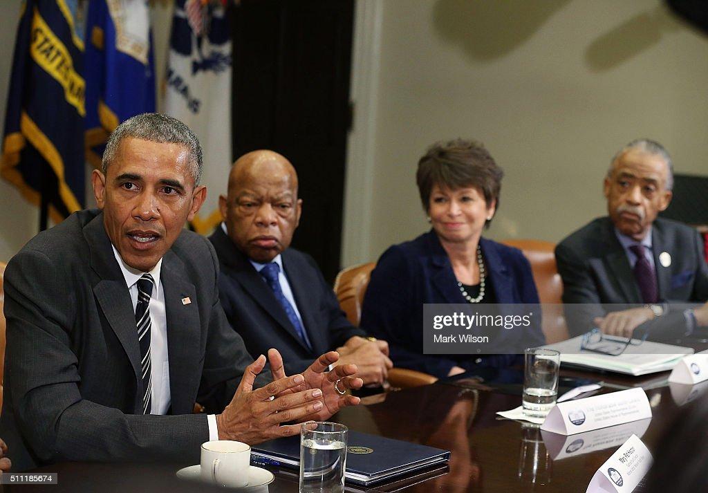 S President Barack Obama speaks about race relations while flanked by Rep John Lewis Senior Advisor Valerie Jarrett and Rev Al Sharpton in the...