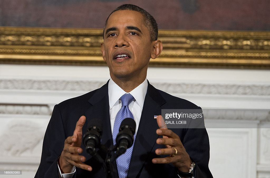US President <a gi-track='captionPersonalityLinkClicked' href=/galleries/search?phrase=Barack+Obama&family=editorial&specificpeople=203260 ng-click='$event.stopPropagation()'>Barack Obama</a> speaks about the reopening of government following a shutdown in the State Dining Room of the White House in Washington, DC, October 17, 2013. AFP PHOTO / Saul LOEB