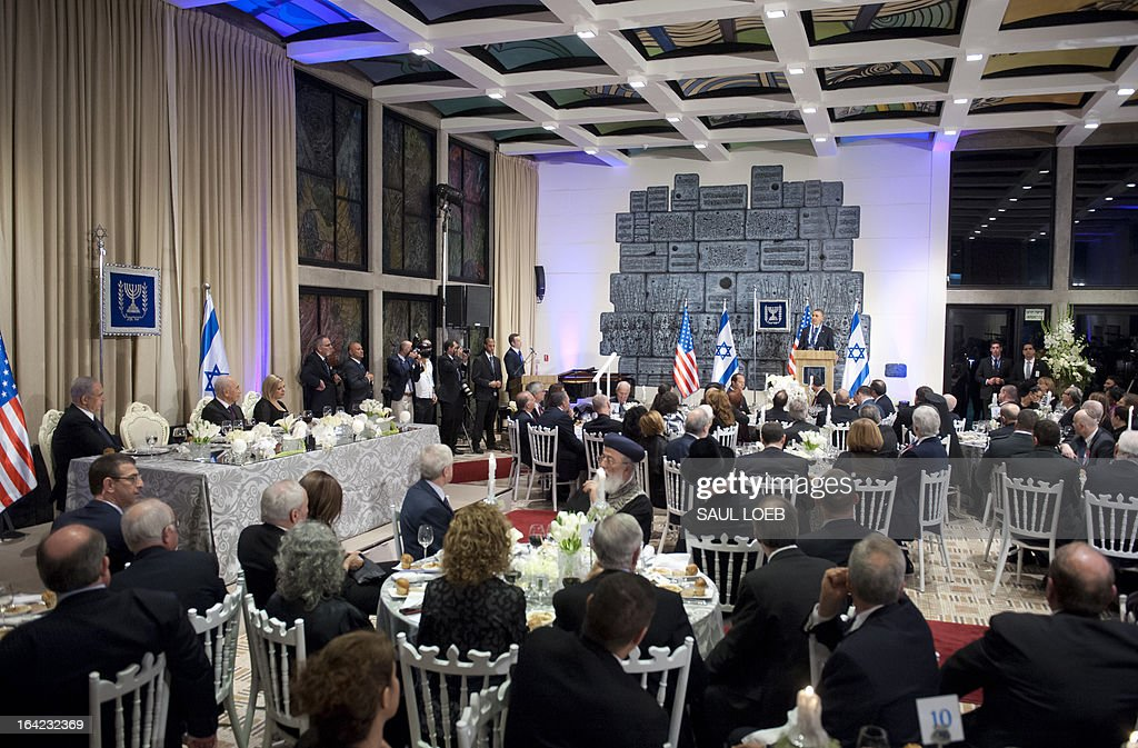 US President Barack Obama speaks after receiving the Presidential Medal of Distinction, the highest civilian honor in Israel, from Israeli President Shimon Peres during an official State Dinner at the President's Residence in Jerusalem, March 21, 2013, on the second day of Obama's 3-day trip to Israel and the Palestinian territories. AFP PHOTO / Saul LOEB