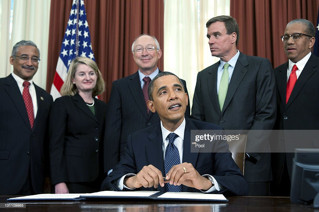 U.S. President <a gi-track='captionPersonalityLinkClicked' href=/galleries/search?phrase=Barack+Obama&family=editorial&specificpeople=203260 ng-click='$event.stopPropagation()'>Barack Obama</a> speaks after signing a proclamation to designate Ft. Monroe in Hampton, Virginia, a National Monument, as (L to R) U.S. Rep. Bobby Scott (D-VA), Hampton, Virgina Mayor Molly Ward, U.S. Interior Secretary <a gi-track='captionPersonalityLinkClicked' href=/galleries/search?phrase=Ken+Salazar&family=editorial&specificpeople=228558 ng-click='$event.stopPropagation()'>Ken Salazar</a>, U.S Sen. <a gi-track='captionPersonalityLinkClicked' href=/galleries/search?phrase=Mark+Warner&family=editorial&specificpeople=2251151 ng-click='$event.stopPropagation()'>Mark Warner</a> (D-VA), Lacy Ward, Jr., Director, Robert Russa Moton Museum, Farmville, Virgina, watch in the Oval Office of the White House on November 1, 2011 in Washington, DC. The fort was used in 1619 by Dutch settlers to bring slaves to the colonies and used in the Civil war as a refuge for escaped slaves.