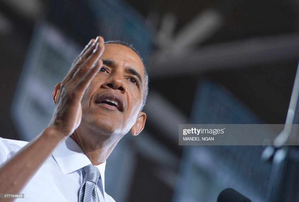 US President Barack Obama speaks after visiting a classroom at Coral Reef High School in Miami, Florida on March 7, 2014. AFP PHOTO/Mandel NGAN