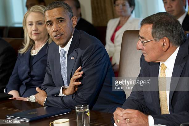 US President Barack Obama speaks alongside Secretary of State Hillary Clinton and Secretary of Defense Leon Panetta as he holds a Cabinet meeting in...