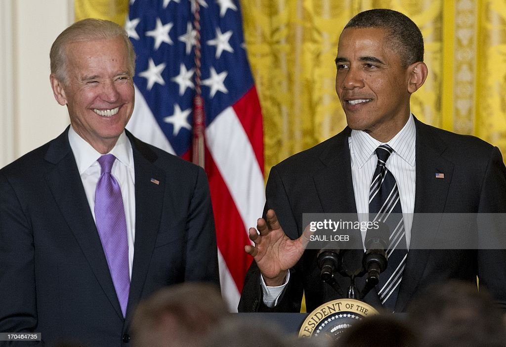 US President <a gi-track='captionPersonalityLinkClicked' href=/galleries/search?phrase=Barack+Obama&family=editorial&specificpeople=203260 ng-click='$event.stopPropagation()'>Barack Obama</a> speaks alongside US Vice President Joe Biden (L) attend a LGBT (the lesbian, gay, bisexual, and transgender community) Pride Month celebration in the East Room of the White House in Washington, DC, on June 13, 2013. He praised the courage of people who came out as being LGBT, and those who supported them. From the Senate to the NBA, Obama said, 'We're reaching a turning point.' He said the US has become more loving as a country. AFP PHOTO / Saul LOEB