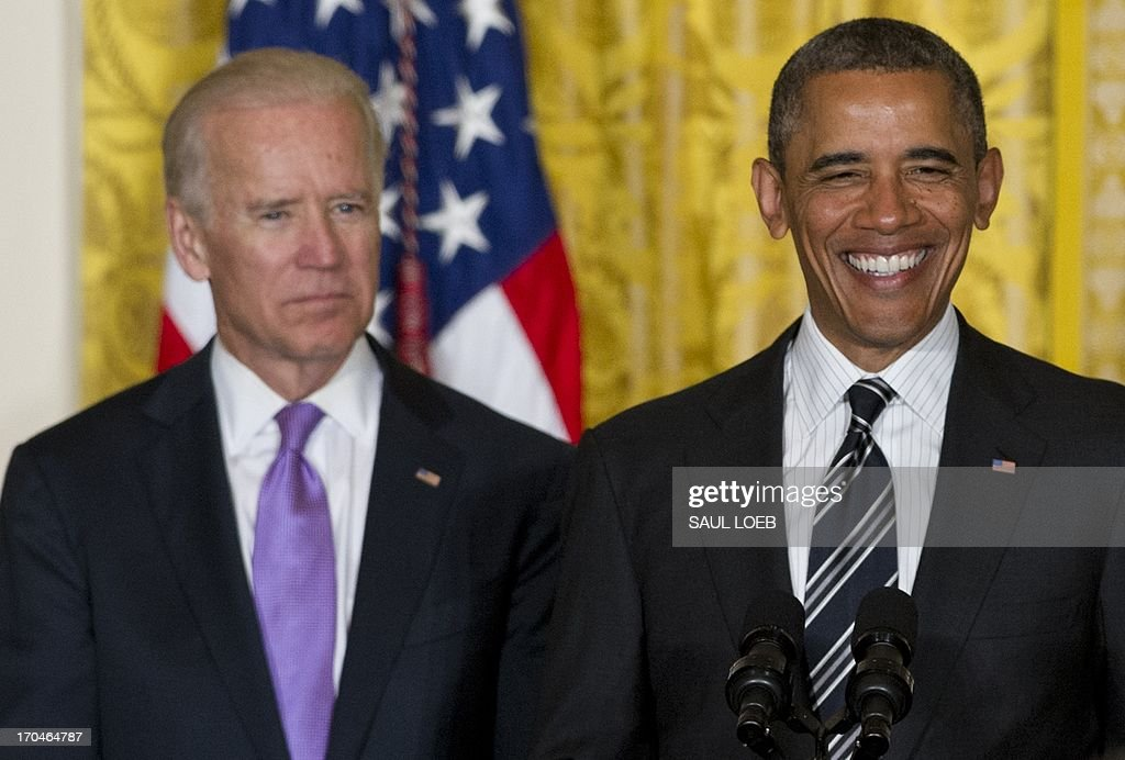 US President Barack Obama speaks alongside US Vice President Joe Biden (L) during a LGBT Pride Month celebration in the East Room of the White House in Washington, DC, June 13, 2013. AFP PHOTO / Saul LOEB