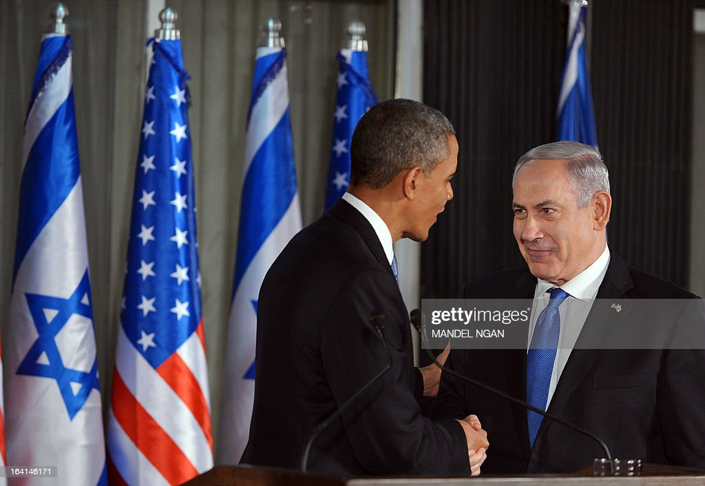 US President Barack Obama (L) speaks and Israeli Prime Minister Benjamin Netanyahu shake hands at a joint press conference following a bilateral meeting at the Prime Minister's residence in Jerusalem on March 20, 2013. Obama landed in Israel for the first time as US president, on a mission to ease past tensions with his hosts and hoping to paper over differences on handling Iran's nuclear threat.
