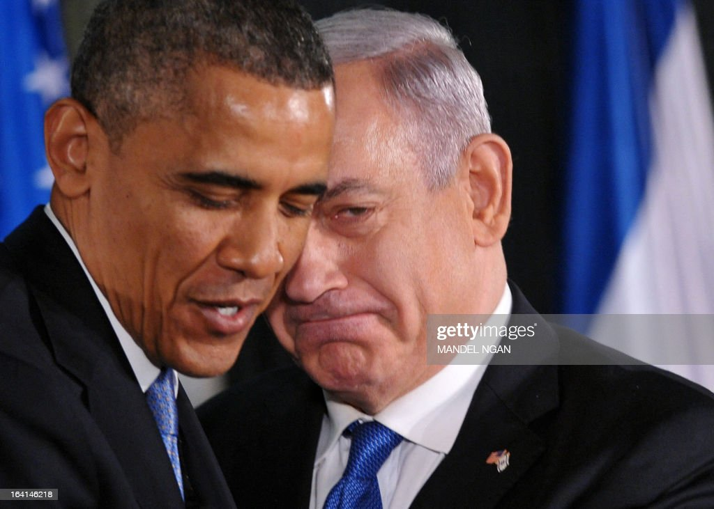 US President Barack Obama (L) speaks and Israeli Prime Minister Benjamin Netanyahu embrace at a joint press conference following a bilateral meeting at the Prime Minister's residence in Jerusalem on March 20, 2013. Obama said Israel and the United States are to 'begin discussions' on extending US military aid to Israel beyond 2017 on his first visit to the Jewish state since taking over the White House. AFP PHOTO/MANDEL NGAN