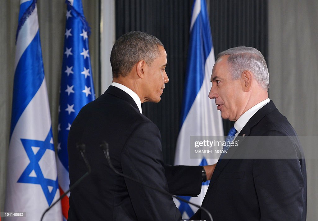 US President Barack Obama (L) speaks and Israeli Prime Minister Benjamin Netanyahu shake hands at a joint press conference following a bilateral meeting at the Prime Minister's residence in Jerusalem on March 20, 2013. Obama landed in Israel for the first time as US president, on a mission to ease past tensions with his hosts and hoping to paper over differences on handling Iran's nuclear threat. AFP PHOTO/MANDEL NGAN