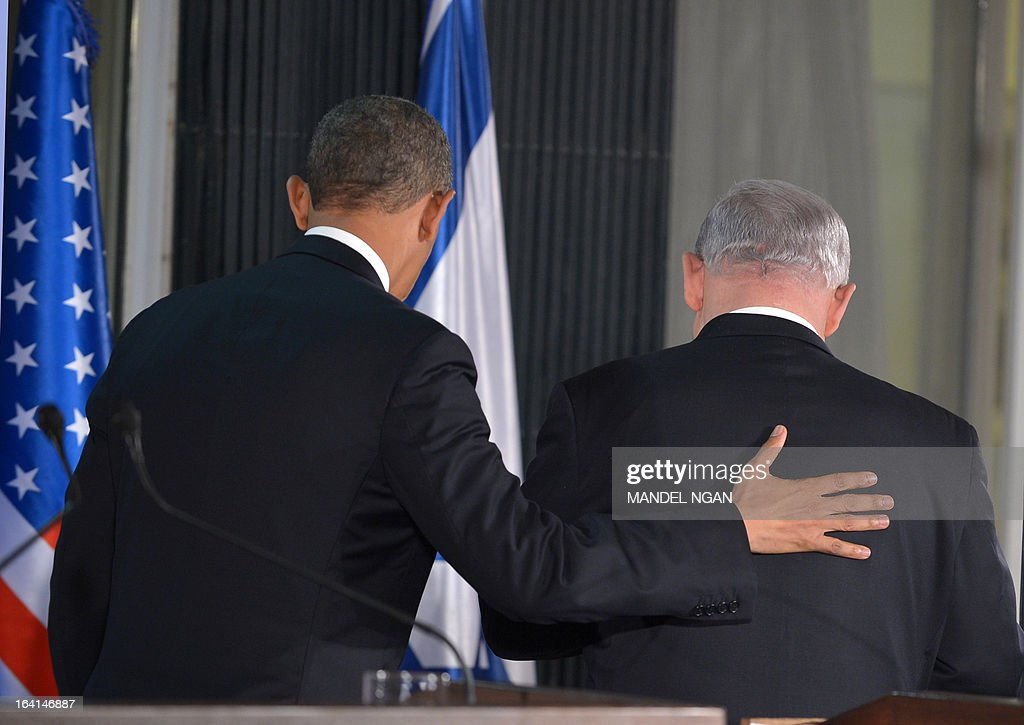 US President Barack Obama (L) speaks and Israeli Prime Minister Benjamin Netanyahu make their way from a joint press conference following a bilateral meeting at the Prime Minister's residence in Jerusalem on March 20, 2013. Obama said Israel and the United States are to 'begin discussions' on extending US military aid to Israel beyond 2017 on his first visit to the Jewish state since taking over the White House. AFP PHOTO/MANDEL NGAN
