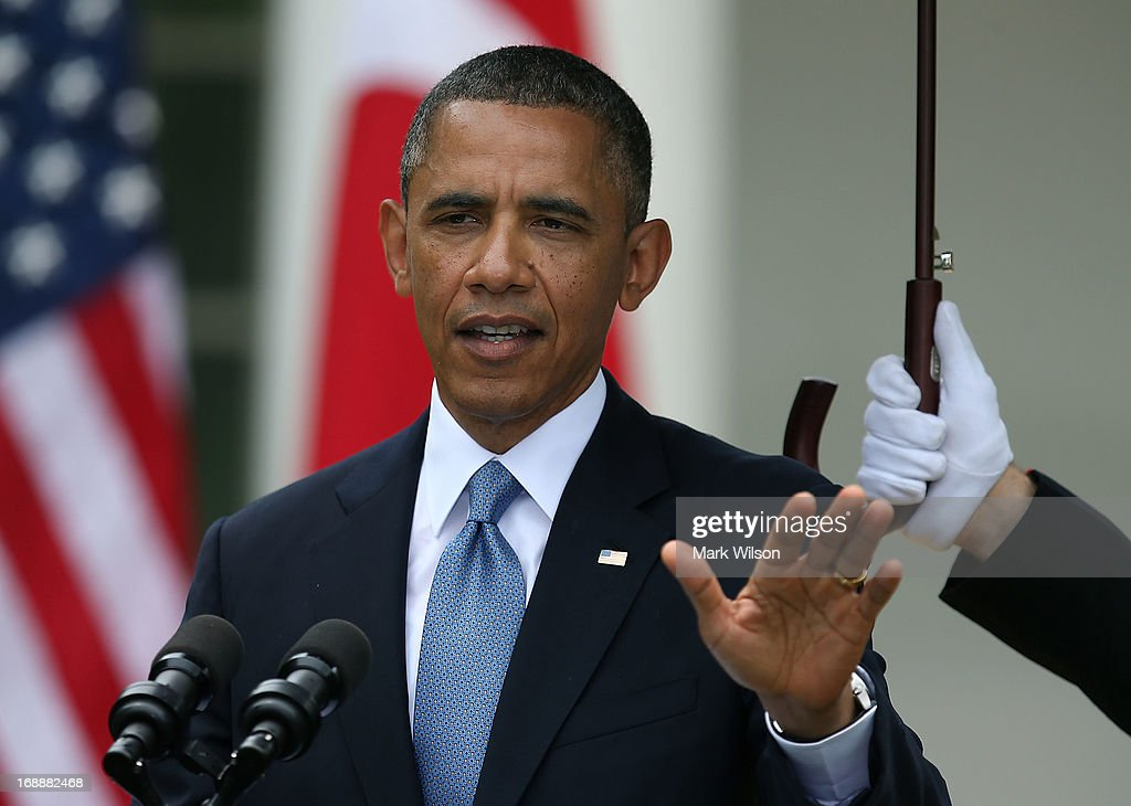 U.S. President <a gi-track='captionPersonalityLinkClicked' href=/galleries/search?phrase=Barack+Obama&family=editorial&specificpeople=203260 ng-click='$event.stopPropagation()'>Barack Obama</a> speaks as a U.S. Marine holds an umbrella over him, during a news conference with Prime Minister Erdogan of Turkey (not shown), in the Rose Garden at the White House, May 16, 2013 in Washington, DC. President Obama answered questions on the IRS Justice Department invesigation and spoke about the situation in Syria.